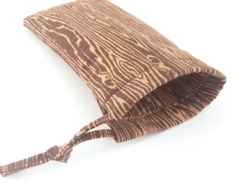 brown wood grain sunglasses case pouch. padded eyeglasses case. small fabric drawstring pouch cotton