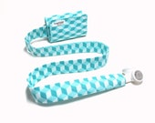 Aqua cubes TuneTube.  Earbud cord organizer for iPhone or iPod.  Cord keeper.  Earbud holder.  Earbud case.