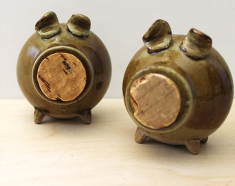 Vintage green pig stoneware salt and pepper shakers.