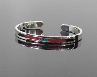 Sterling silver cuff bracelet with turquoise, red coral and black onyx stone inlay