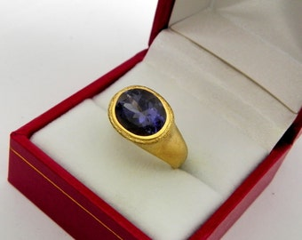 AAAA Iolite Violet Blue   11x9mm  2.92 Carats   in Ladies 18K Yellow gold cocktail ring 10 grams. 2632