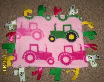 Homemade John Deere pink, ribbon blanket