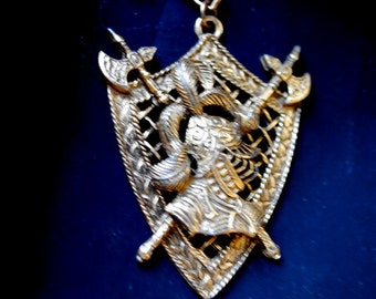 Renaissance vintage 50s gold tone metal necklace with  ornate, shield style, filigree  pendant and french soldier as a centerpiece.
