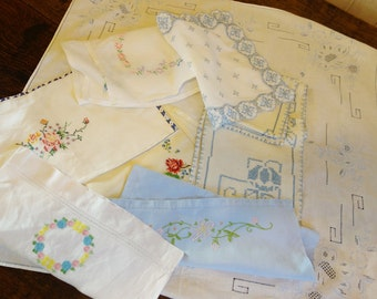 bundle of vintage embroidered items including blue embroidered tablecloth