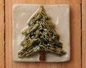 Handmade 4x4 ceramic Evergreen tree tile comes with a hanger on the back, suitable for tile installation