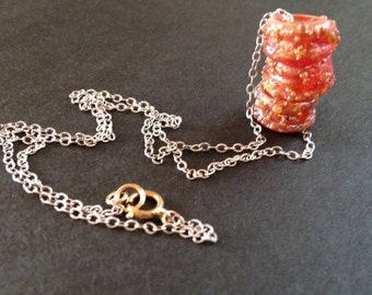 artisan crafted glass beads with sparkly frit. ruby grapefruit color. beads on a chain necklace. whisper necklace