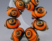 Special Order for voodosuzie - 8 graduated black and orange handmade lampwork glass beads - More Serious Contrast