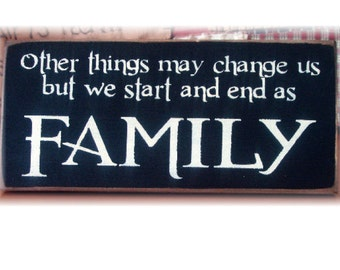 Other things may change us but we start and end as FAMILY wood sign