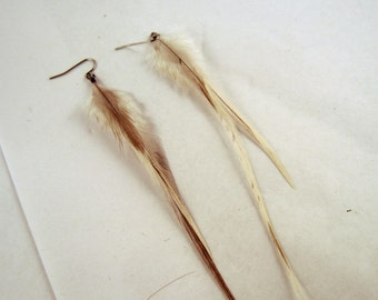 thin white feather earrings natural with grey