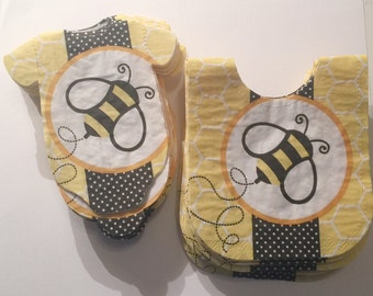 Any quantity baby shower 'shirt' or 'bib' paper napkins with big yellow and black bumble bee