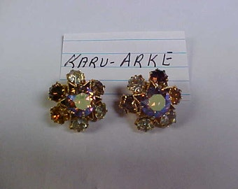 Signed Karu-Arke clip on ear rings- amber and clear rhinestones