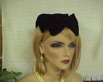 50's black velvet hat fashioned with large velvet bows- spreads to fit