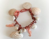 ON SALE Vintage Celluloid Chain Bracelet with Shells Baubles and Seahorse Charms