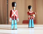 A Regal pair of Danish wooden soldiers designed by Kay Bojesen...