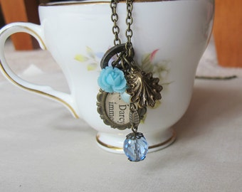 Jane Austen Charm Necklace Pride and Prejudice Pastel Blue Beaded Mr Darcy. Skeleton Key Vintage Upcycled. Brass Literature Flower Shell