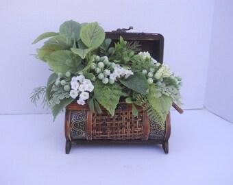Artificial Greenery Arrangement in Decorative Trunk