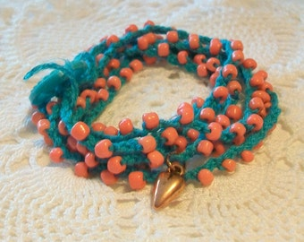 Bohemian bracelet, Stacked bracelet, Beads and string, Orange and turquoise, Button closure, Heart charm dangle
