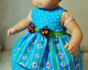 """Two Bitty Baby dresses """" Blueberry Baby"""" and """"Pretty in pink""""  with bloomers and bonnet"""