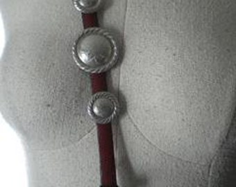 Leather belt with silver color conches