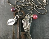 Skeleton Key Necklace with Create Charm, Wing Charm and Heart charm