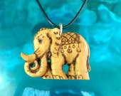 LUCKY ELEPHANT PENDANT in Satin Wood with Leather Cord and Sterling Silver, Hand Carved by Susana Caban