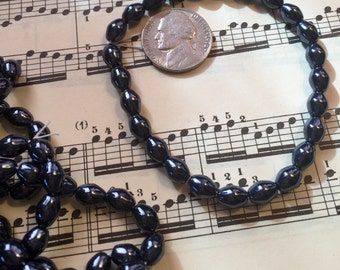 Vintage  beads  metallic  Steel gray oblong Czech glass faux pearls one strand Hematite