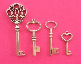 The Large Key Collection - 4 different antique silver tone key pendants CC2