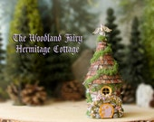 Woodland Fairy Hermitage Cottage of The Bewildering Pine - Miniature Round House with Mossy Tile Roof, Fairy Door and Blooming Flower Vine