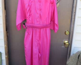 1970  gorgeous Hot pink shiny wetlook silk batwing style  jumpsuit romper with belt   size..14 comes with nylon matching neck scarf
