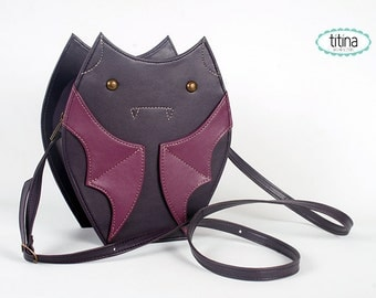 purple and grape fauxleather bat bag