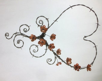 Regal Barbed Wire Heart With Tooled Leather Looking Tin Forever Blooming Flowers