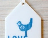 porcelain tag screenprinted text love with bird.
