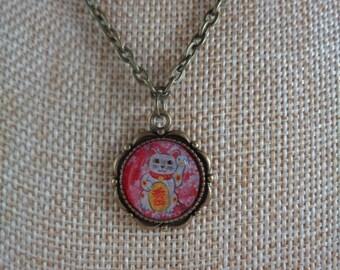 Red and pink maneki neko necklace