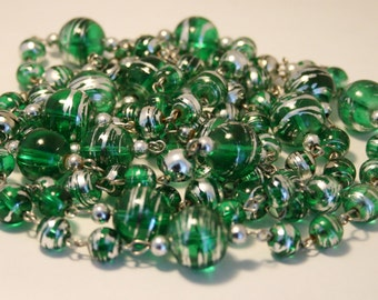 Vintage green glass bead necklace.  Long necklace