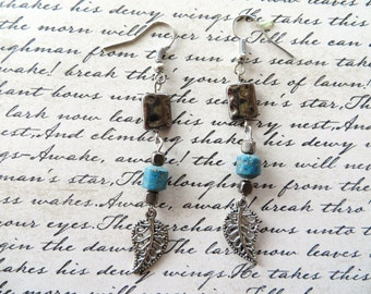 Silver Leaf Charm Dangling Earrings With Blue Stone And Gunmetal Accents