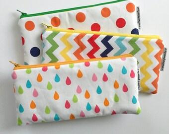 set of three rainbowtized XL pen pouches
