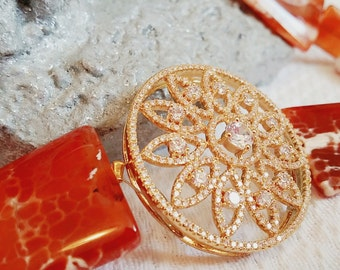 Alta Marea Stones collections Red Orange Sardonyx with round crystal pendant.