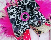 Over the top hair bow with ostrich feathers. Hot pink, damask, leopard 6 inches wide
