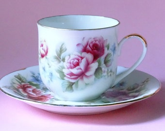 Angelique cup and saucer with pink roses and light blue flowers