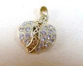 Sale 20 Vintage 1970s rhinestone marcasite fret work heart Valentines Day pendant.