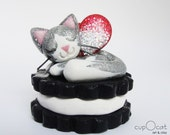 Chocolate Cookie Cat Fairy - A glittery silver and white cat figurine with red and silver wings