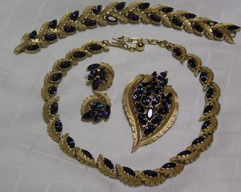 Crown Trifari 1950s flashes of purple and blue rhinestone navettes in gold tone vines full parure