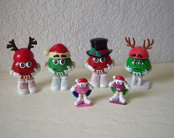 Four M & M Christmas Candy Holder Figures plus two spinners