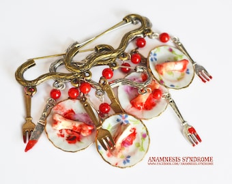 Bloody brooches or earrings, cannibal bones and blood diner!