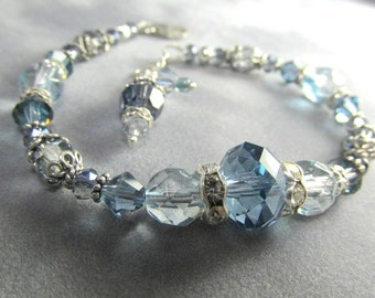 Swarovski Bracelet in Light Blue and Shades of Gray in Sterling Silver with adjustable chain and lobster claw clasp