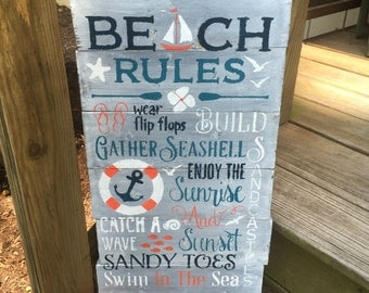 Beachl Rules sign, outdoor wooden beach sign