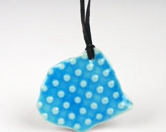 necklace with a porcelain pendant