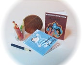 Dolls house miniature childs colouring books and pencils.
