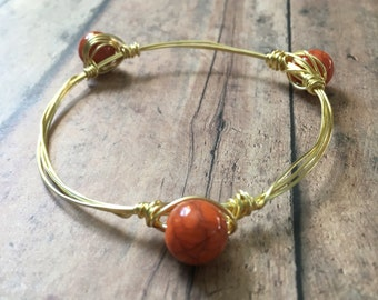 Orange stackable wire wrapped mix and match bangle