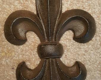 Fleur-de-lis wall decor, cast iron